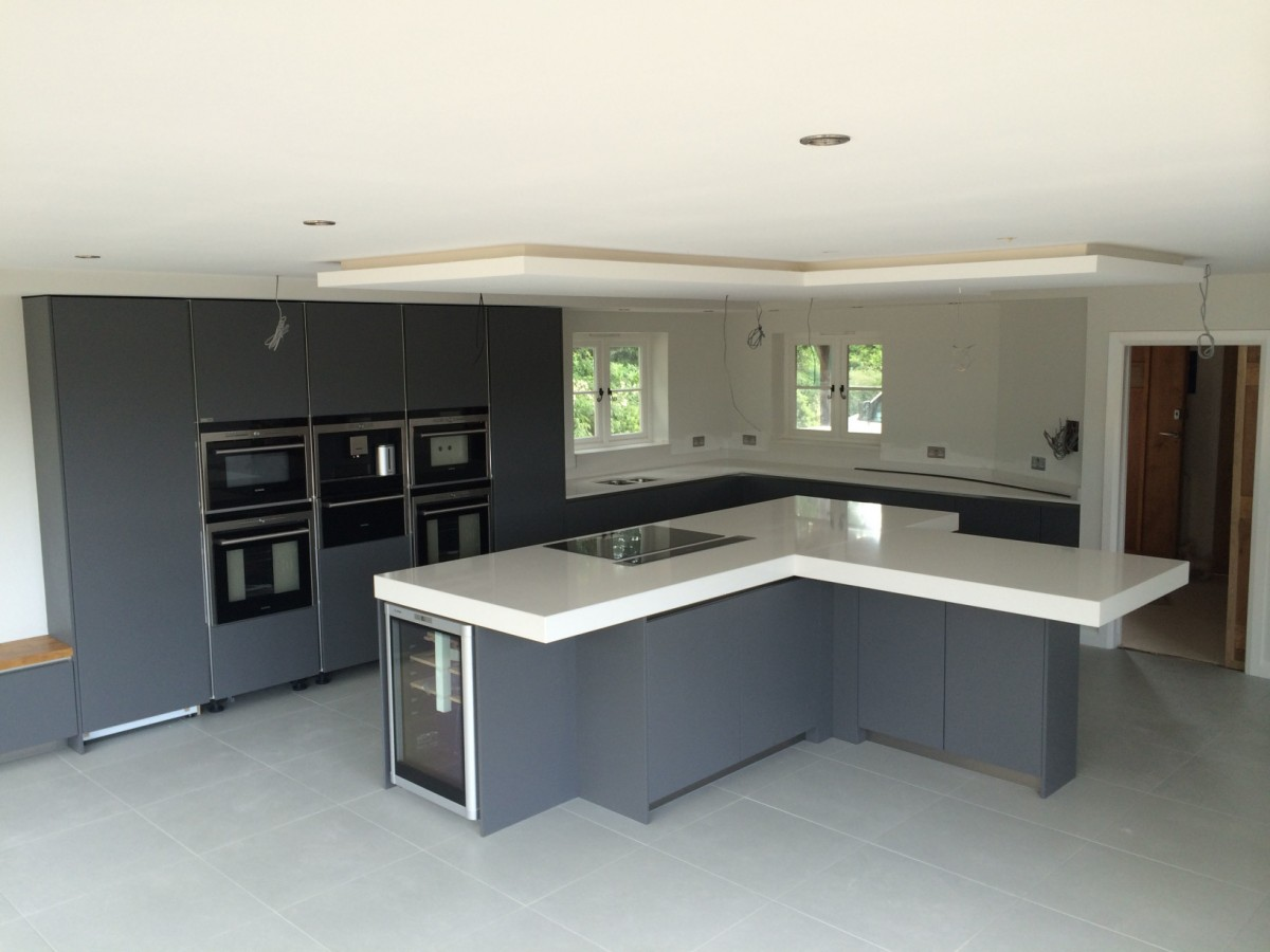 Handleless satin grey lacquer kitchen with 100mm quartz for Kitchen units on one wall