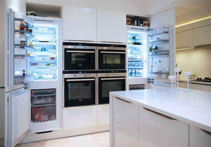 Siemens fridges in white gloss kitchen haywards heath
