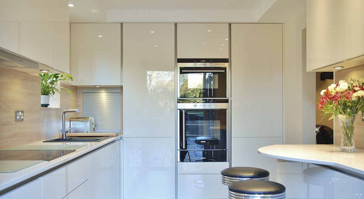 handleless cream kitchen crawley down ovens and fridges