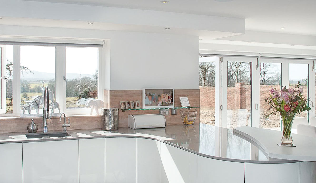 Handleless White Curved Kitchen with Quartz - Hurstpierpoint