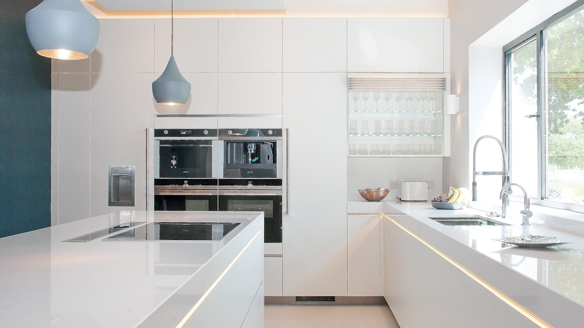 white satin kitchen with white quartz worktops