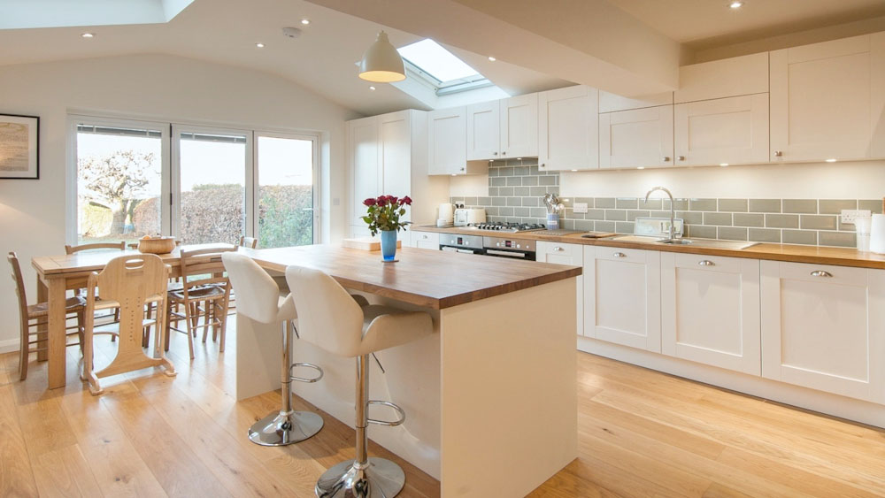white shaker kitchen wooden worktops with island
