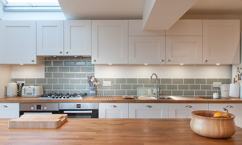 white shaker kitchen green metro tiles